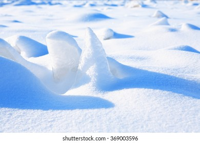 Winter landscape. Closeup of snow and ice under sun