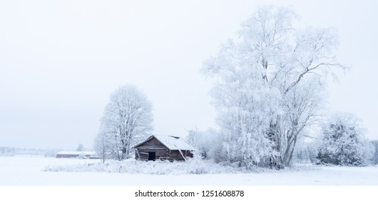 Winter landscape in the countryside with a barn