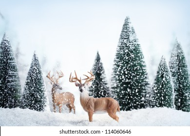 Winter landscape with deers,snow and fir tree.