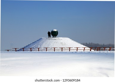 Winter landscape of the Dnipro city Waterfront, streets and a pyramid covered with snow. Dnepropetrovsk, Ukraine,
