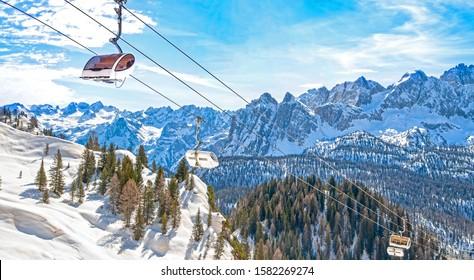 Winter landscape in Dolomites at Cortina D'Ampezzo ski resort, Italy, Monte Castello area, chair lift installation