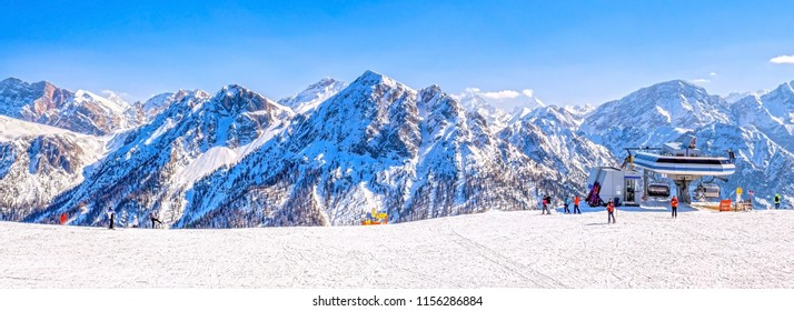 Winter landscape in Dolomites, ski slope with cable lift in Plan de Corones / Kronplatz with mountain range in background