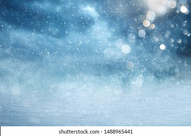 Winter landscape with falling snow