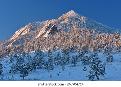 Winter landscape of the Flatirons on Bear Peak at sunrise, Rocky Mountains, Boulder, Colorado, USA