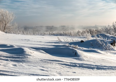 Winter landscape with frost, mist and drift