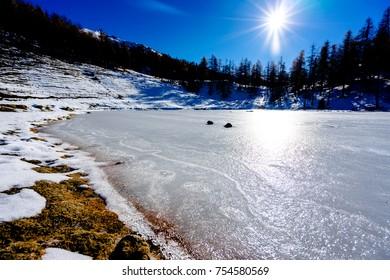 Winter landscape with frozen lake at Lago Laune Sauze D'Oulx Piedmont