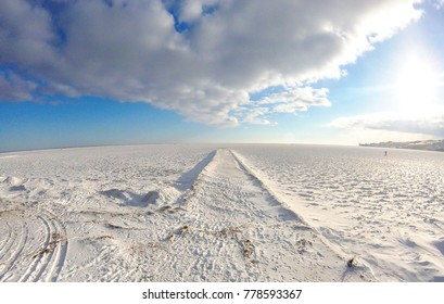 Winter landscape with frozen sea, snow, ice and pier that goes into infinity, Nida, Lithuania