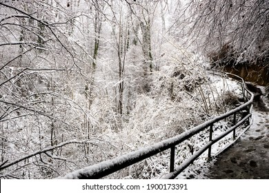 Winter landscape fully covered with fresh snow and a waterfall