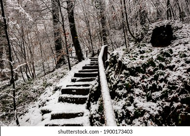 Winter landscape fully covered with fresh snow with handrail and stairs
