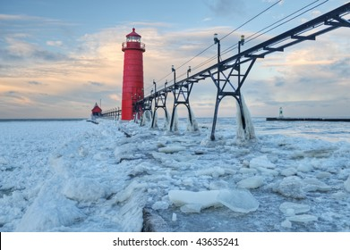 Winter landscape of the Grand Haven, Michigan Lighthouse, iced pier and catwalk, Lake Michigan, USA
