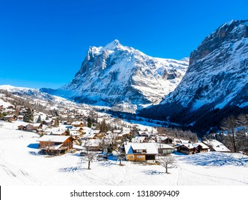 Winter landscape in Grindelwald at sunrise, behind the Mittelhorn and Wetterhorn, Wetterhorn, Interlaken-Oberhasli, Bernese Oberland, Canton of Bern, Switzerland