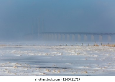 The Winter landscape has came to Oresund with the bridge in the background