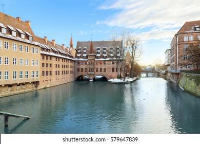 Winter landscape of The Hospital of the Holy Spirit on Pegnitz river in Nuremberg, Bavaria, Germany