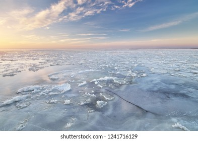 Winter landscape. Ice on water surface. Composition of nature.