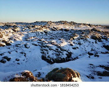 Winter landscape in Iceland. A field of solidified lava covered with moss is covered with snow
