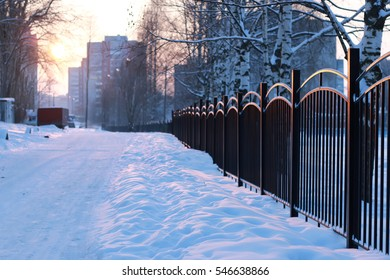 winter landscape iron fence at sunset