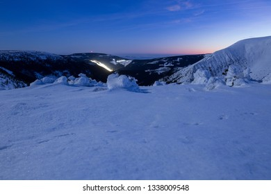 Winter landscape of the Krkonose during a fullmoon night in winter