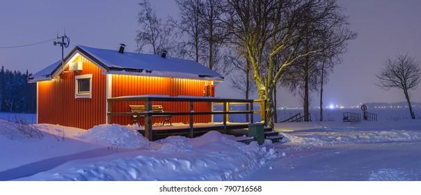 Winter landscape with a little scandinavian house.
