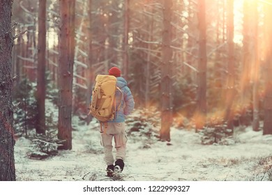 winter landscape man with a backpack / nature landscape a man on a hike with equipment in snowy weather in Canada