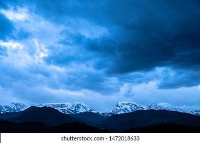 Winter Landscape Mountain Peaks Covered In Snow Over Field Aerial