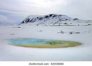 Winter landscape with mountain and pond
