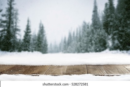 Winter landscape of mountains and wooden old table with snow