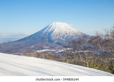 Winter Landscape of Mt.Yotei with snow hill or slope and blue sky in Niseko Ski area, Hokkaido, Japan