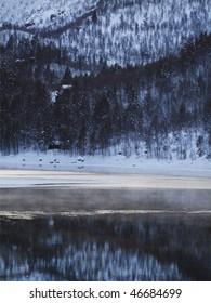 Winter landscape in the Norwegian mountains, misty lake