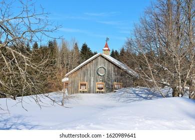 Winter landscape with old barn - Shutterstock ID 1620989641