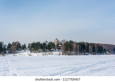 Winter landscape with old stone Church on the beautiful river Bank.