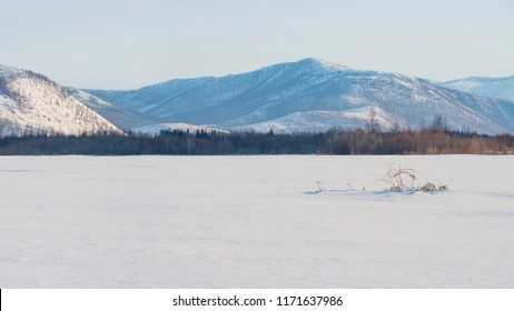 Winter landscape on the mountains and the frozen lake in Yakutia