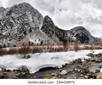Winter landscape on the river. Alpine mountain river in winter on a cloudy day