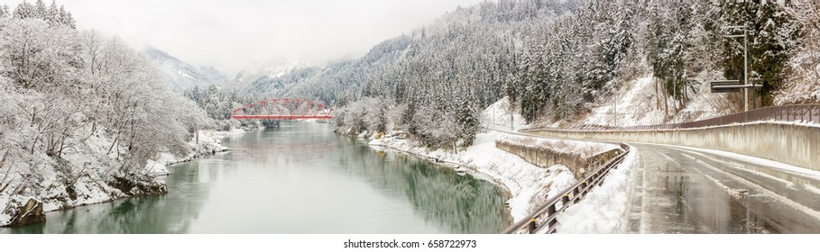 winter landscape with Red Bridge along Tadami River in Fukushima Japan Panorama