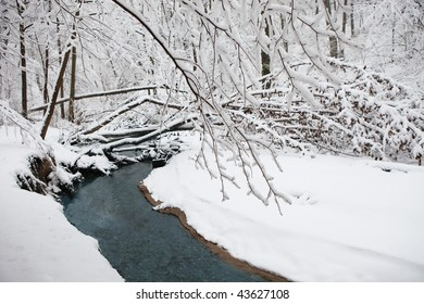 Winter landscape with the river in frosty day.