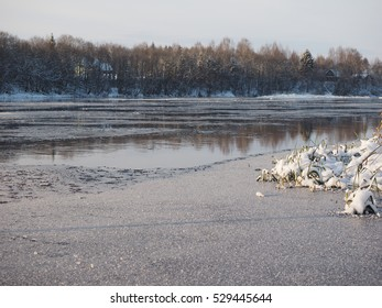Winter landscape with the river in frosty day