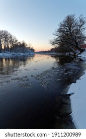 Winter landscape of the river at sunset.