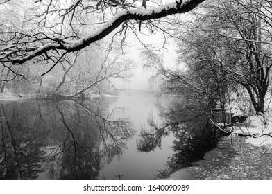 Winter landscape at river with trees aside. Molndal, Sweden.