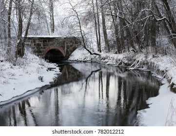 Winter landscape at riverside with old renovated stone bridge. Photographed in Bon, Eidsvoll, Norway.
