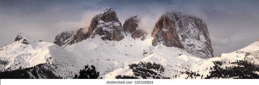 Winter landscape of Sasso Lungo mountains group (Lang Kofel) in the italian Dolomites. Sassolungo or Langkofel is the highest mountain of the Langkofel Group in the Dolomites in Italy.