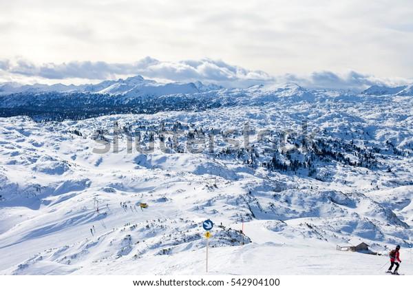 Winter landscape scene in a ski resort in Austria, snow, mountains, trees
