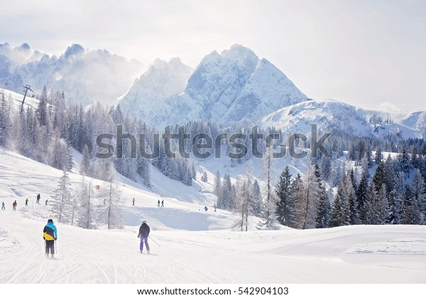 Winter landscape scene in a ski resort in Austria, snow, mountains, trees