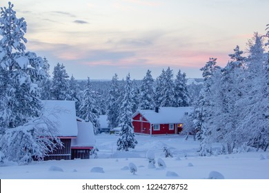 Winter landscape scenery in Lapland, Scandinavia with snow and traditional houses