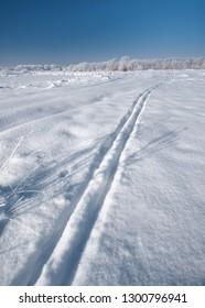 Winter landscape. Ski track. Winter scene in Central Russia