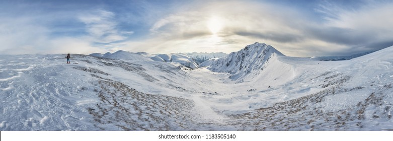 Winter landscape, a ski track in the snow, mountains of the Altai. The Altai Republic. Traveling to the mountains in the winter.