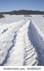 Winter landscape with ski track and sun
