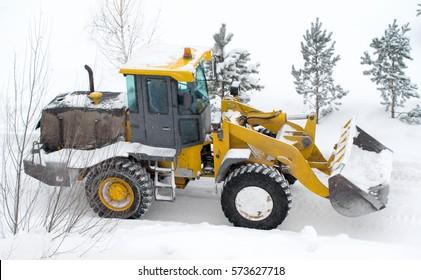 Winter landscape, snow cleaning machine