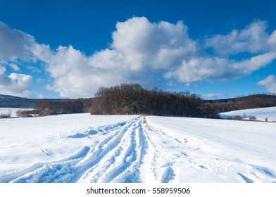 Winter landscape with snow and clouds
