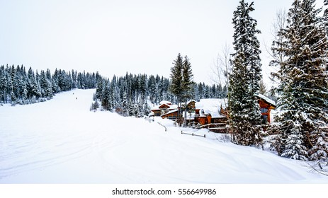 Winter Landscape with Snow Covered Roofs in the Alpine Village of Sun Peaks in the Shuswap Highlands of central British Columbia, Canada