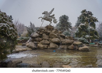 Winter landscape with snow falling in a beautiful theme park in Greece, Europe