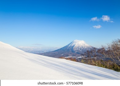 Winter Landscape of snow hill and Mt.Yotei with blue sky and cloud in Niseko, Hokkaido, Japan